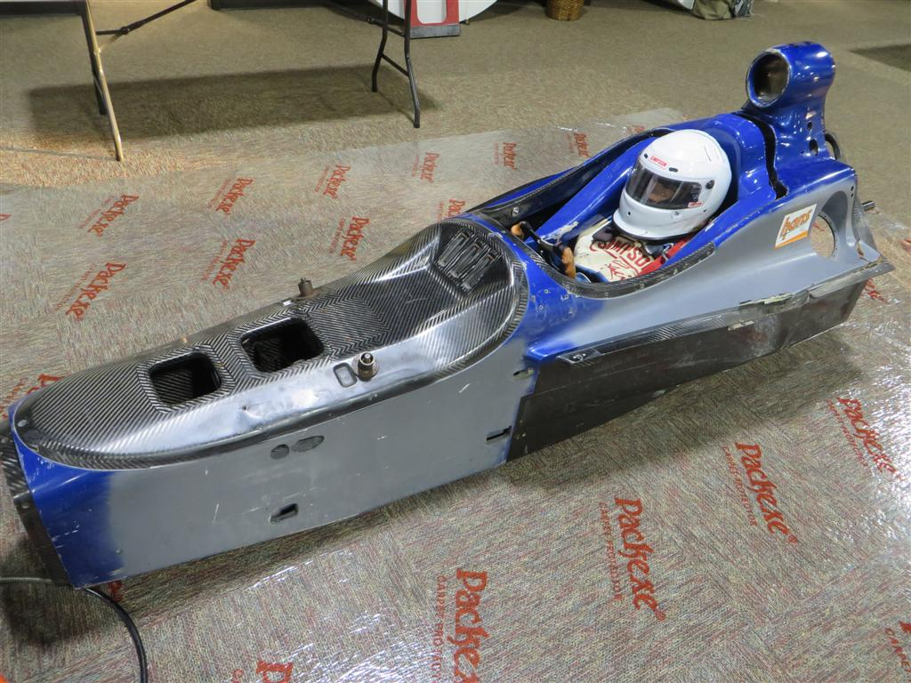 Racing tub for extrication demo, practice, and in car tourniquet application
